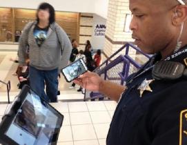 Collin County Sheriff Deputy George White checks a hallway in one of Anna (Texas