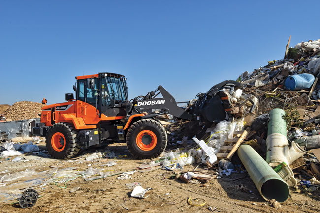 A small wheel loader performs waste handling duties.