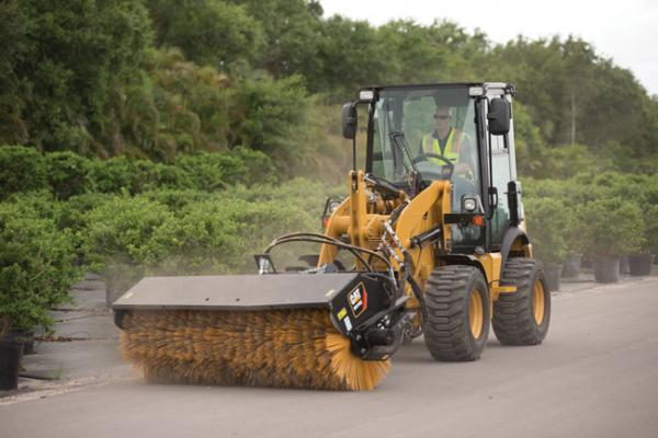 Caterpillar 903D wheel loader can use attachments.