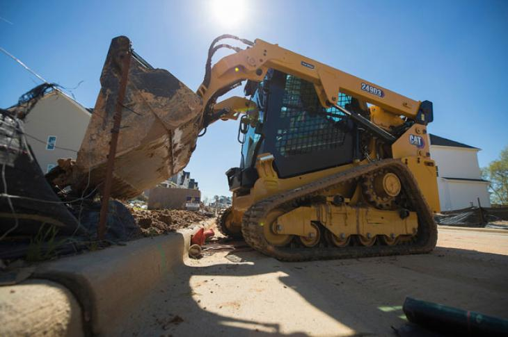 Cat 249D3 compact track loader works on a project.