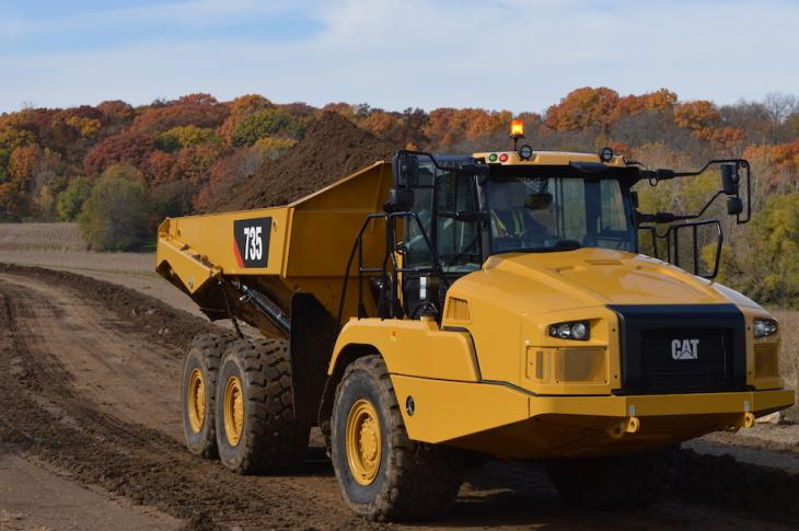 The Cat 735 driving with a full dumper on site.