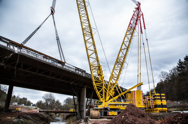 Barges are sometimes used to position a lattice boom crane close to bridge projects