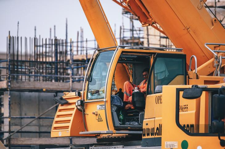 Worker in the cab of a heavy machine.