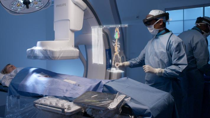 Philips and Microsoft have partnered to develop an augmented reality system to help imporve workflow and procedural navigation in the cath lab. Physicians wearing visors can view and interact with true 3-D holograms above the patient on the table and manipulate the image with voice and hand motion commands to avoid breaking the sterile field.
