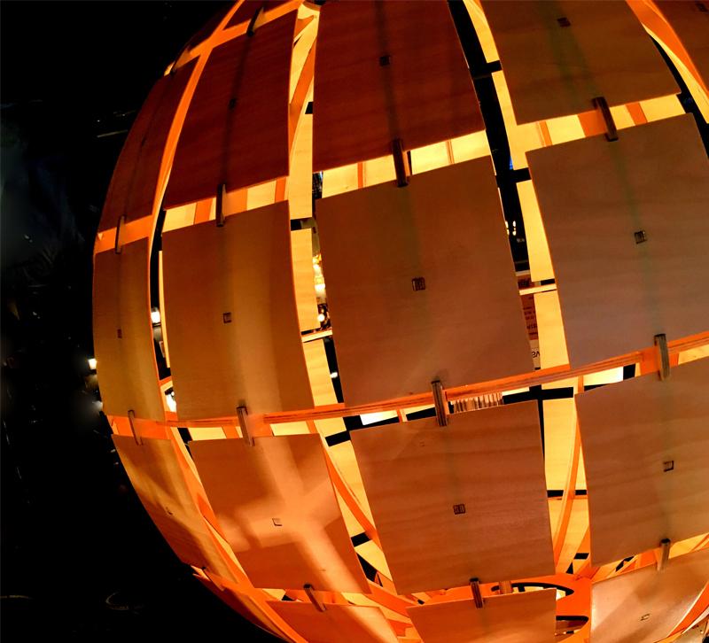 wood light fixture in the dark