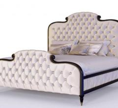 cream upholstered bed