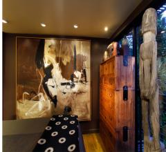 Room with recessed lighting and bright artwork on the walls