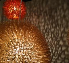 Spiky orb pendants in gold and red from Light Play frosted light bulbs