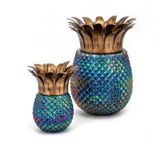 Waipio Small and Large pineapple-shaped Hurricanes with a blue iridescent bottom and gold top from IMAX Worldwide Home
