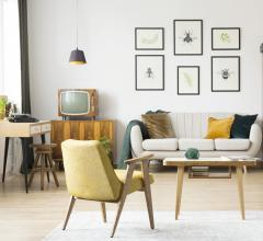 Living room featuring Mid-Century Modern furniture and Eurofase lighting for artwork
