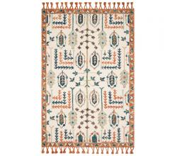Kasuri Ivory/Persimmon Area Rug with an orange border and tassels from Loloi Rugs