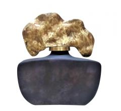 Gray Glass Bottle with charcoal-shaped topped in gold from Sagebrook Home