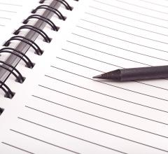 blank notebook paper and pen