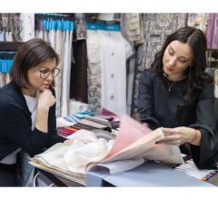 Adobestock women looking at fabric samples