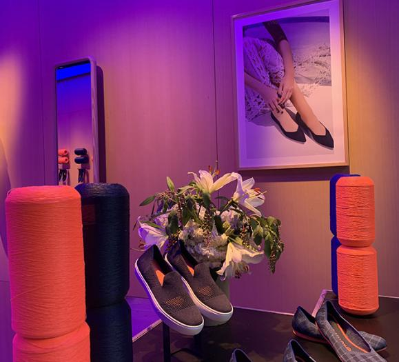 colorful, theatrical lighting at Rothy's shoe store.