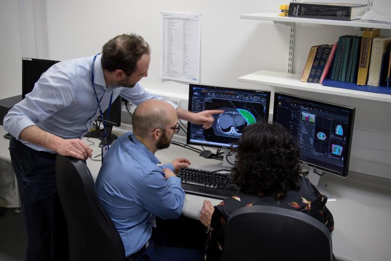 Chris Walker, head of radiotherapy physics, with the team at NCCC.