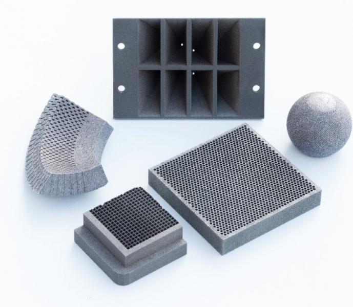 Examples of complex 3-D printed tungsten prototypes formed by additive manufacturing techniques.