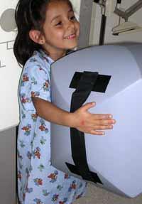 Pediatric Positioning Aid Comforts Child, Improves Image