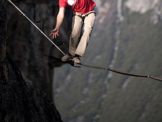 Person walking tightwire