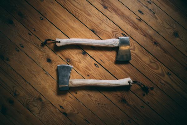 Two axes on wooden board
