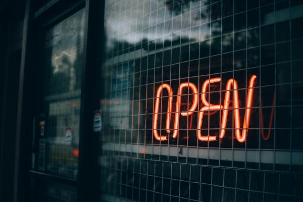 Illuminated 'open' sign in a window