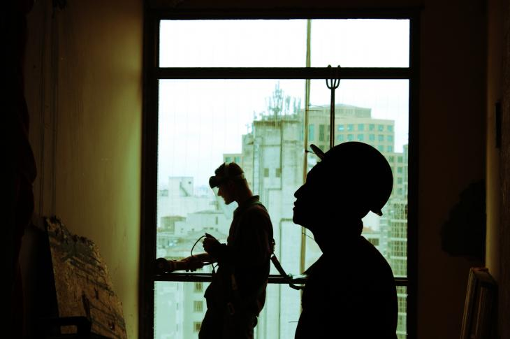 construction workers in prefab structure