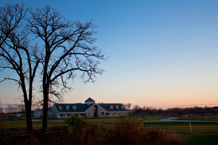 Sunset_behind_farm_building