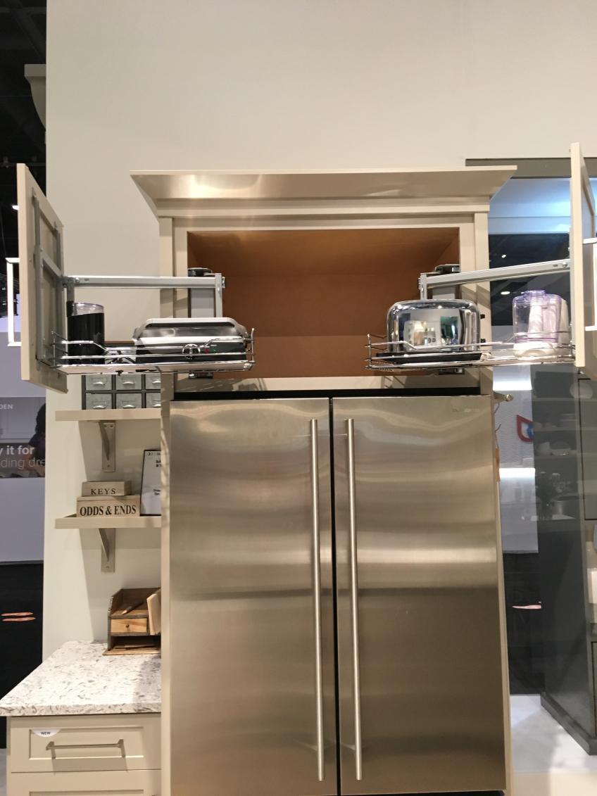 Diamond Cabinets has introduced a refrigerator wall cabinet with a shelf that pulls out toward the user, making it easier to see and reach heavy, odd-shaped or less-frequently used items.